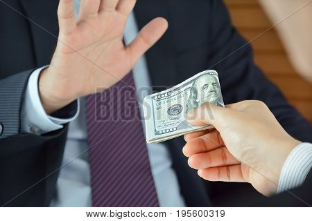 Businessman refusing money uncorrupted concept - soft focused