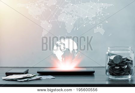 Online banking and internet banking and network concept Saving money and account banking for finance business networking concept Laptop with smartphone mobile and coin money on business office table