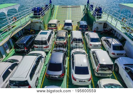 Labuan,Malaysia-June 26,2017:View of vehicles on the ferry that use a ferry to cross the South China Sea from Labuan island to Sabah.This is the economical transportation to the Labuan Pearl of Borneo
