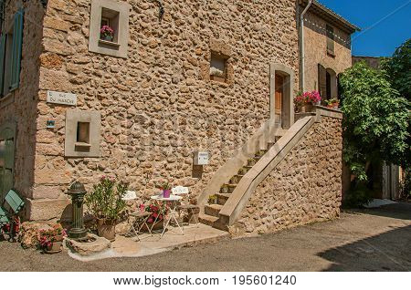 Sillans-la-Cascade, France - July 10, 2016. View of buildings with staircase in alley, at the quiet Sillans-la-Cascade village, near Draguignan. Provence region, Var department, southeastern France