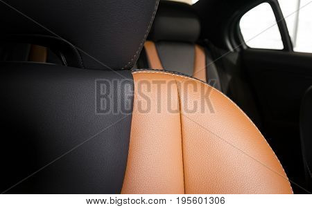 Modern sport car  red leather interior, part of the passenger seat