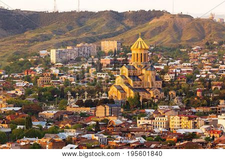 Aerial view on Holy Trinity Cathedral of Tbilisil (Sameba). Sunset view on Tbilisi Georgia.