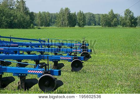 Agricultural equipment ready for ploughing the fields