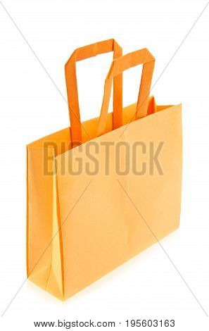 Orange shop bag of origami, isolated on white background.