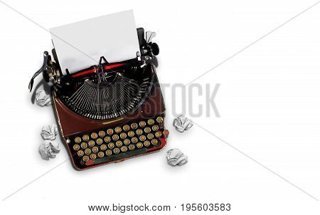 Vintage typewriter from top view over white