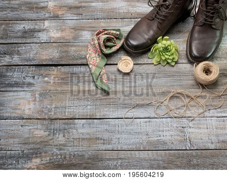Accessories for travel top view on wooden background with copy space. Adventure and wanderlust concept image with travel accessories.