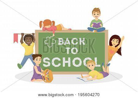 Back to school. Kids stand near the green chalk board. Happy children at school.