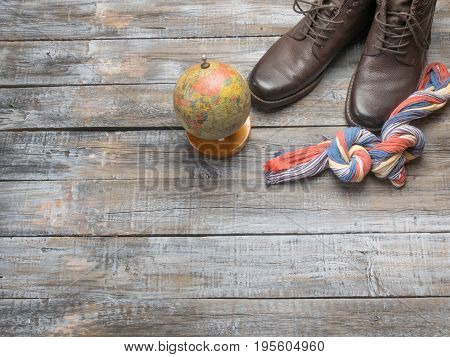 Accessories for travel top view on wooden background with copy space. Adventure and wanderlust concept image with travel accessories