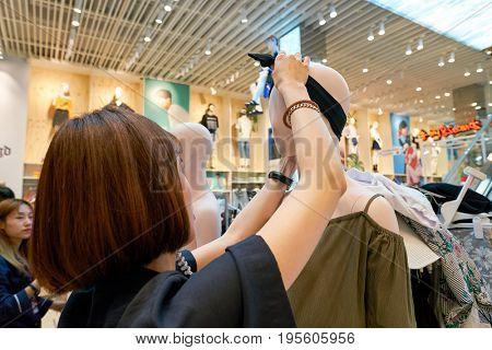 SEOUL, SOUTH KOREA - CIRCA JUNE, 2017: worker at 8 seconds store in Seoul.