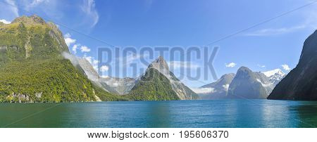 Famous Mitre Peak rising from the Milford Sound fiord. Fiordland national park, New Zealand. Panoramic photo