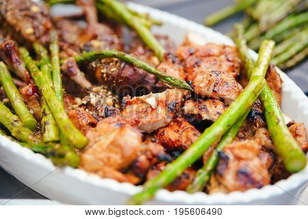 Fried Green Asparagus With Chicken Thighs, Dining Concept Of Nutrition. Buffet. Food.