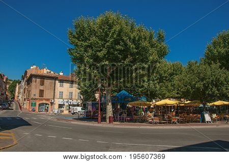 Les Arcs-sur-Argens, France - July 10, 2016. Square view with restaurants in the city center of the medieval hamlet of Les Arcs-sur-Argens. In the Provence region, Var department, southeastern France