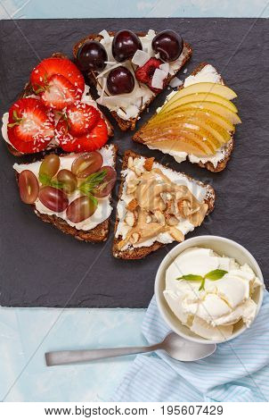 Sweet sandwiches with mascarpone cheese and berries pear and peanut butter.