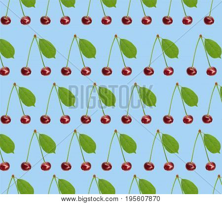Seamless pattern sweet fresh cherry with green leaf isolated on blue background
