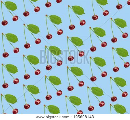 Seamless pattern sweet fresh cherry with green leaf isolated on blue backgroundy