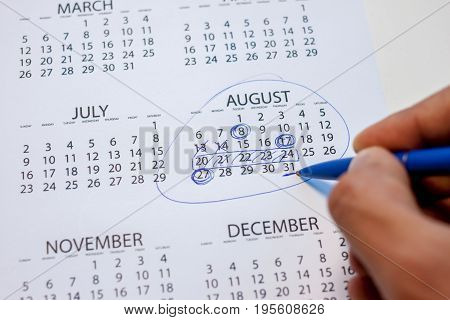 pen marks on the calendar plan for month
