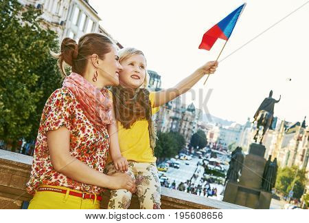 Happy Mother And Daughter Tourists In Prague Rising Flag