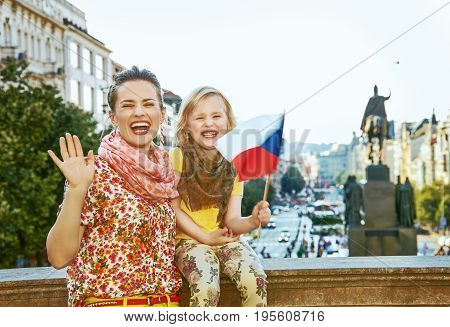Mother And Child Travellers With Czech Flag Handwaving
