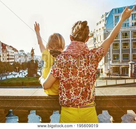 Mother And Daughter Travellers In Prague Rejoicing