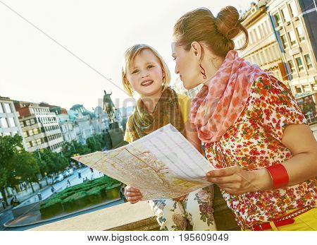 The spirit of old Europe in Prague. happy young mother and child travellers on Wenceslas Square in Prague Czech Republic with map