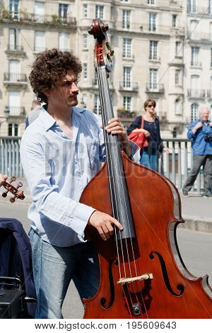FRANCE, PARIS - MAY 08, 16: Cellist plays in the center of Paris