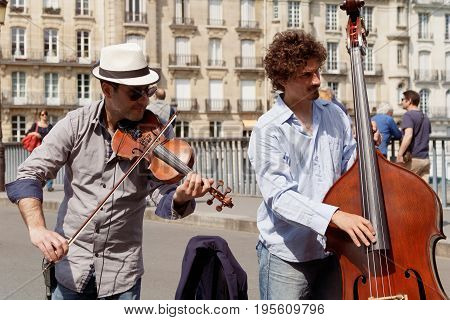 FRANCE, PARIS - MAY 08, 16: Street musicians in the center of Paris
