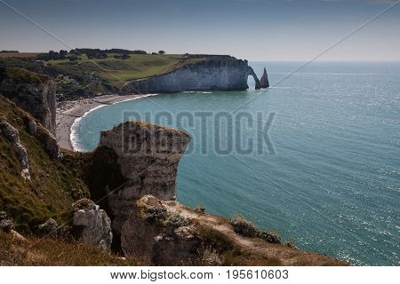 The Porte d'Aval, L'Aiguille and pebbled beach at Etretat, a commune in the Seine-Maritime department in the Normandy region of north western France