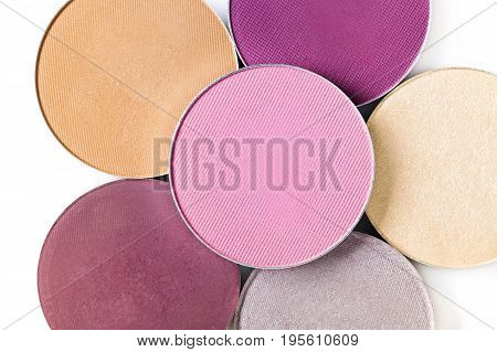 Beige and pink eye shadow on the white background