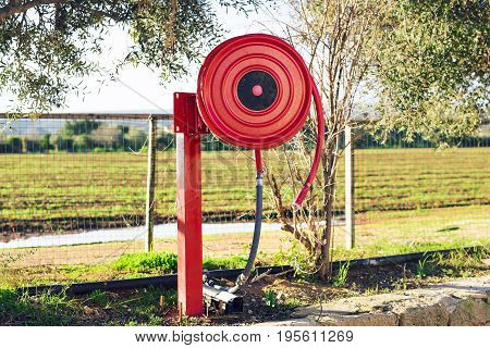 Fire safety equipment. Fire hose in the garden