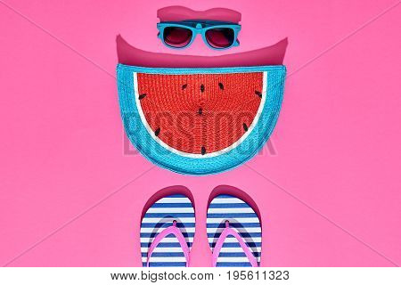 Beach Sunny Set. Fashion Summer Accessories, Film Camera, Glamor Watermelon Clutch, Stylish Sunglasses, Trendy Flip Flops on Pink. Hot Vibes. Sweet Bright summer color. Creative Fun. Minimal, Art