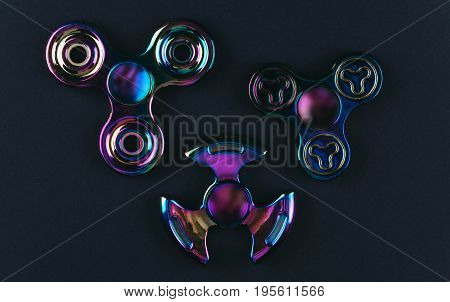 Group of hand fidget spinner toys on black background. Stress and anxiety relief.