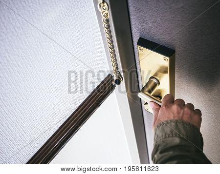 Hand holding Door handle Hotel room lock