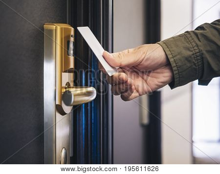 Hand Holding Key card Hotel room access