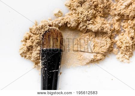Broken brown eye shadow and brush  on the white background