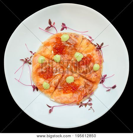 Salmon fillet and roe on Indian roti bread, uneven plate, isolated on black