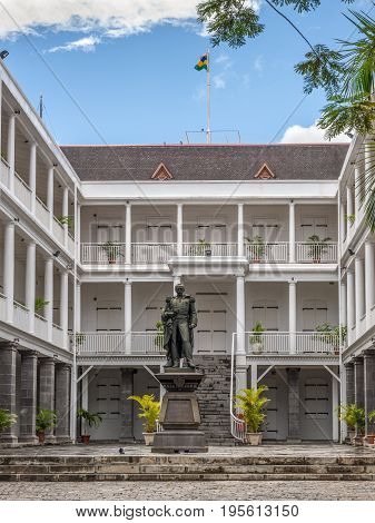 Port Louis Mauritius - December 25 2015: Statue of Sir William Stevenson Governor of Mauritius Government House in Port Louis Mauritius.