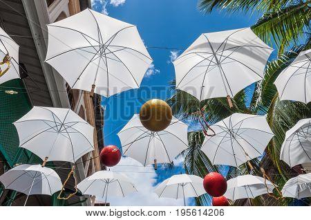 Port Louis Mauritius - December 25 2015: Umbrella art display in street at Caudan Waterfront Port Louis Mauritius.