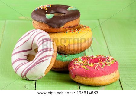 pile of glazed donuts isolated on white background.