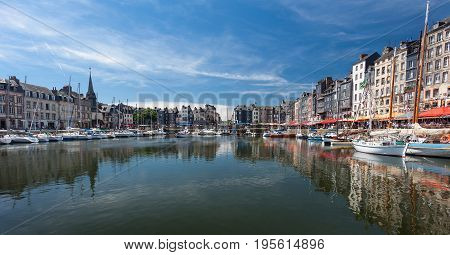 Editorial Honfleur, France - July 05, 2017: Honfleur harbour in France's Normandy region, sited on the estuary where the Seine river meets the English Channel