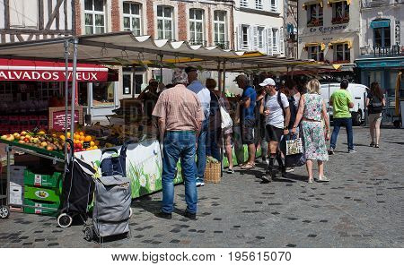 Editorial Honfleur, France - July 05, 2017: A weekly street market in the town of Honfleur in Normandy, France, where local farmers, cheese makers and craftsmen sell their produce