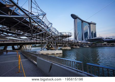 SINGAPORE - JUNE 17 2014 : Bridge and road to Marina Bay Sands Hotel Singapore