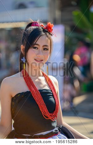 CHIANGMAI THAILAND - JANUARY 25 2015: Indigenous girl with local traditional costume in parade of 22nd Traditional Skirt Fabric and The Indigenous Product and Culture Festival in Mae Chaem Chiangmai Thailand