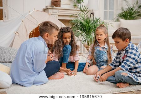 Multicultural Children Playing Domino Game Together At Home