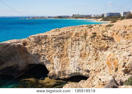 Rock cliffs and sea bay with azure water near Ayia Napa, Cyprus island