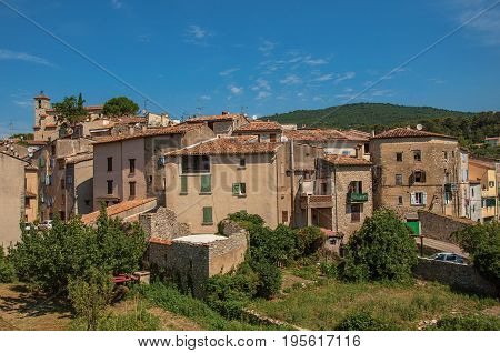 Panoramic view of the houses of the quiet and charming village of Figanières, on a hot and sunny summer day. Located in the Var department, Provence region, southeastern France