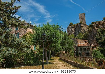 View of houses facing the garden and cliff in Châteaudouble, a quiet and tourist village with medieval origin on a sunny day. Located in the Var department, Provence region, southeastern France