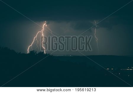 Lightning Strikes Over the Horizon. Stormy Summer Night in the Lesser Poland.