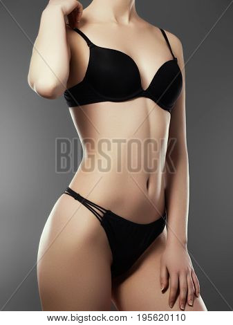 Beautiful Slim Woman's Body. Perfect Slim Toned Young Body Of The Girl. Fitness Or Plastic Surgery A