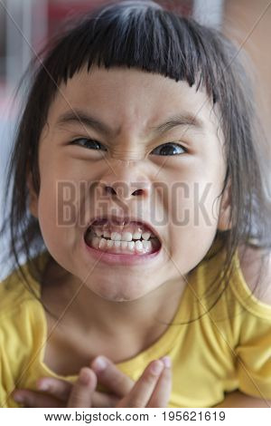 funny face of asian children grin toothy face