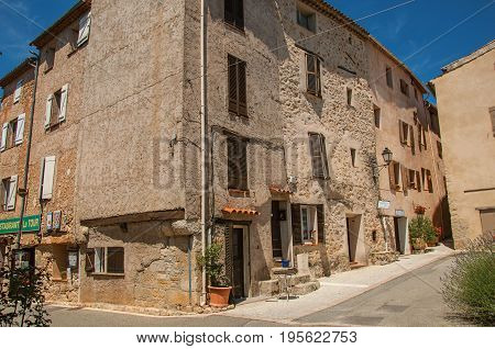 Châteaudouble, France - July 11, 2016. Street corner with buildings and shops in Châteaudouble, a quiet and tourist village with medieval origin. Var department, Provence region, southeastern France